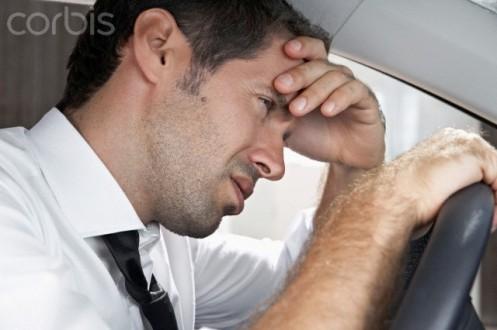 Spain, Dispressed businessman driving car