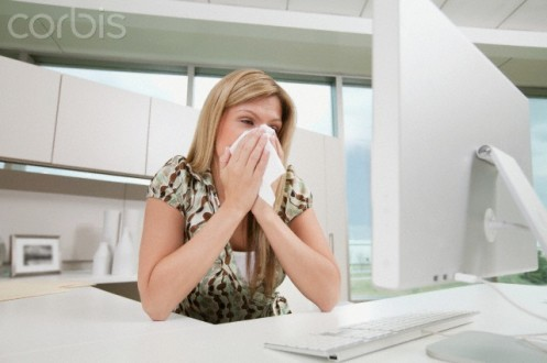 Office worker sneezing