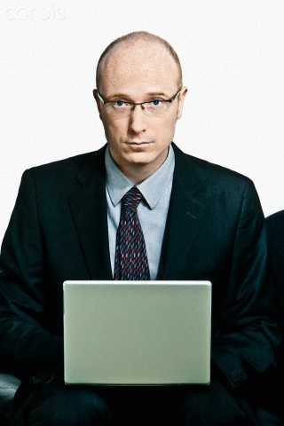 Studio portrait of businessman with laptop