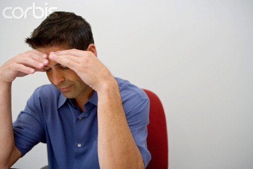 Man in Office with Hands on His Head